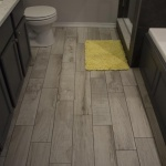 Stately weathered-wood tiling sets this master bathroom off from the competition!